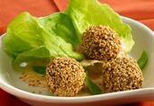 Toasted Sesame Seed-Crusted Lamb Meatballs with Sweet Harissa Yogurt Sauce